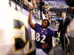 Torrey Smith high-fives fans after his two TD performance in the Ravens' win.