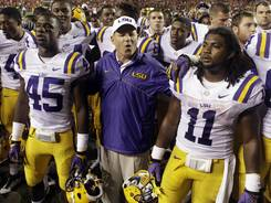 LSU head coach Les Miles sings the alma mater with his team after the 12-10 win over Auburn on Saturday.
