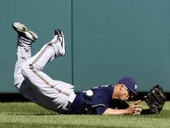 Brewers center fielder Carlos Gomez dives but misses a fly ball hit by the Nationals' Jayson Werth during the fourth inning. Two runs scored on the play.