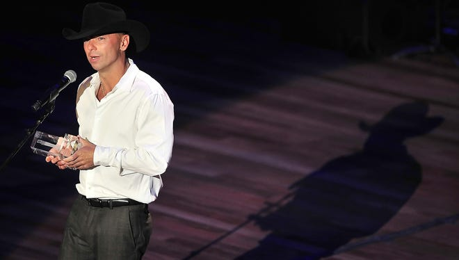 Kenny Chesney accepts the Crystal Milestone award during ACM Honors.