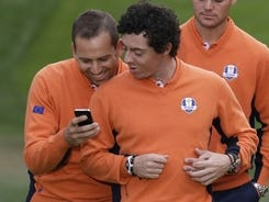 Sergio Garcia shares a laugh with European teammate Rory McIlroy before a team picture Tuesday in advance of the Ryder Cup.