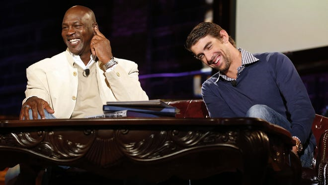 Michael Jordan (left) and Michael Phelps as seen at Golf Channel's 'Feherty Live From the Ryder Cup', on Monday at the Tivoli Theatre in Downers Grove, Ill.