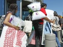 Shoppers carry their purchases at a Target in Chicago.