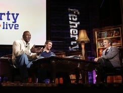 """This photo provided by Gof Channel shows Michael Jordan, left, and Michael Phelps laughing during taping for """"Feherty Live"""" with David Feherty."""