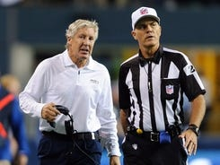 ; Seattle Seahawks head coach Pete Carroll talks with a referee during Monday night's game against the Green Bay Packers.