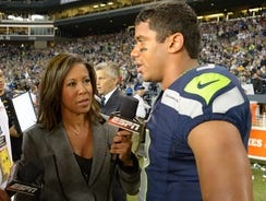 """ESPN reporter Lisa Salters interviews Seahawks quarterback Russell Wilson after Seattle's controversial victory on """"Monday Night Football."""""""