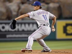 Rangers starter Yu Darvish  delivers a pitch during a game against the Angels on Sept. 20 at Angel Stadium in Anaheim, CA.