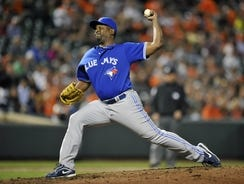 Toronto Blue Jays pitcher Darren Oliver (38) pitches in the eighth inning against the Baltimore Orioles at Oriole Park at Camden Yards. The Blue Jays defeated the Orioles 4 - 0.