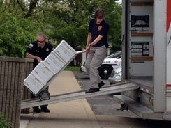 FBI and DEA agents seize boxes from the office of Dr. Gary Shearer in Florence, Ky. on April 17, 2012.
