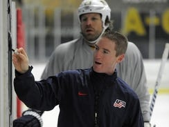Shawn Allard works with Nashville Predators players during an informal practice in Franklin, Tenn.