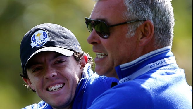 Rory McIlroy, left, and vice captain Darren Clarke face the U.S. in the Ryder Cup starting Friday.