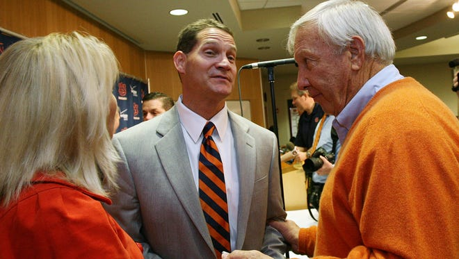 Auburn football coach Gene Chizik, left, and speaks with former Auburn coach Pat Dye after Chizik was hired in 2008.