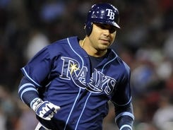 Carlos Pena rounds the bases after hitting a two-run homer, which helped the Rays top the Red Sox and  win their seventh consecutive game.