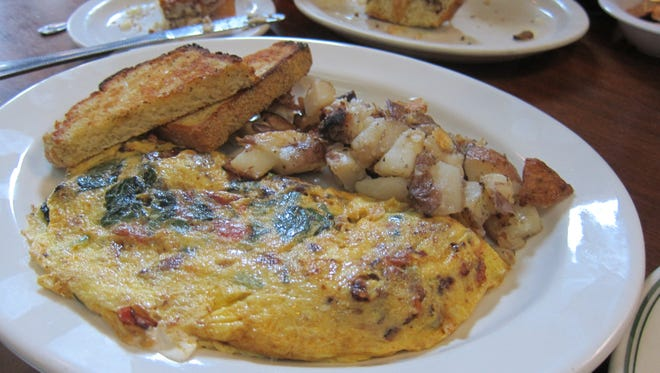 The special omelets and scrambles at Dottie's are another trademark. This is the lamb merguez sausage, roasted garlic, tomato, spinach and goat-cheese omelet with buttermilk-dill toast and home fries.