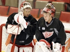 Chris Osgood, left, is barred from having contact with  Jimmy Howard during the lockout because Osgood is now management.