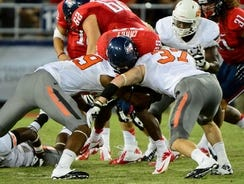 Arizona of the Pac-12 and Oklahoma State of the Big 12 squared off earlier this season.