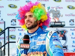 Jimmie Johnson celebrates in Dover's victory lane on June 3 with a wig that he got from a child earlier in the day.