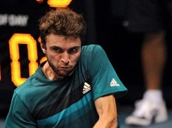 Gilles Simon of France plays a shot against Go Soeda of Japan during their men's singles second round match at the ATP PTT Thailand Open tennis tournament in Bangkok on Sept. 27, 2012.