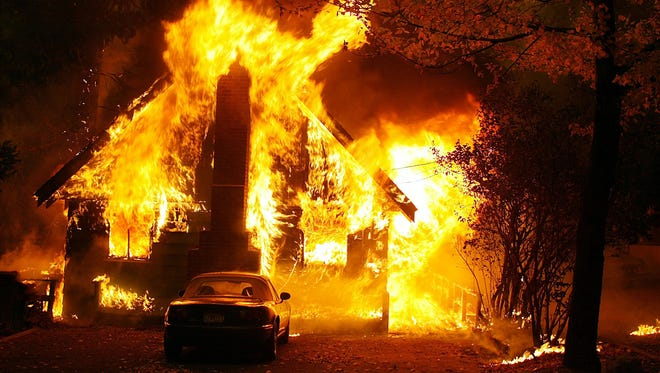 A house in the path of the Old Fire goes up in flames in Cedar Glen, Calif., on Oct. 29, 2003.  The Old Fire was one of the most deadliest California wildfires in a decade.