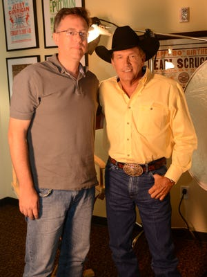 USA TODAY music critic Brian Mansfield, left, and singer George Strait at the Country Music Hall of Fame.
