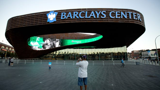 The exterior of the new Barclays Center in Brooklyn, where the the  Nets will begin playing this season, features a large overhang outside the main entrance.