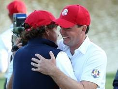 Phil Mickelson and Keegan Bradley embrace after defeating Rory McIlroy and Graeme McDowell on Friday in an afternoon fourball match. The duo scored two points for the USA on Friday.