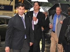 Mathieu Schneider, left, leads NHL Players' Association negotiators into league  headquarters in New York.