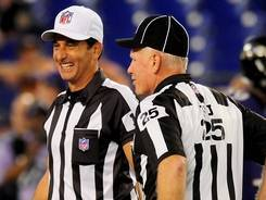 Referee Gene Steratore, left, and his crew received a warm welcome in Baltimore.