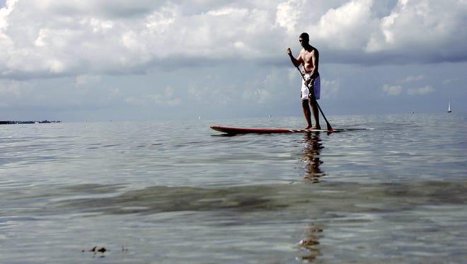 Paul Adams of Orlando, Fla., paddle boards on Key Biscayne.