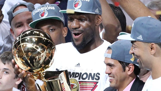 LeBron James and the  Heat met expectations last season. Can they do it again?