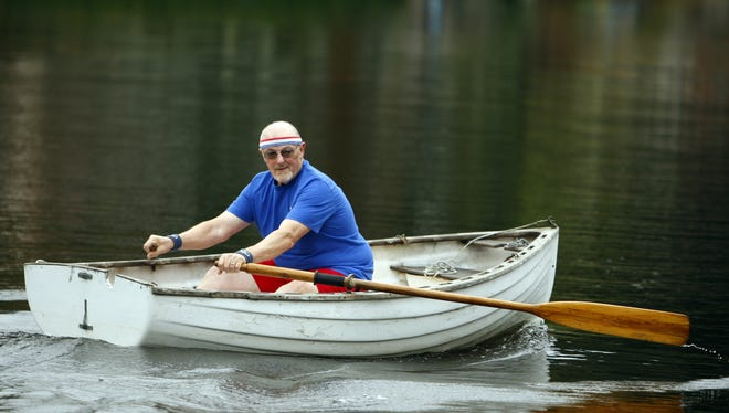 Jim Kiefert, a 23-year cancer survivor, goes out in a rowboat on the lake near his house.