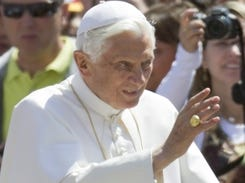 Pope Benedict XVI delivers his blessing as he arrives at the Vatican in May.