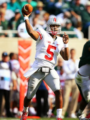 Ohio State quarterback Braxton Miller threw for 179 yards and ran for 135 more in the Buckeyes' win in East Lansing.