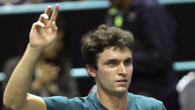 Gilles Simon of France celebrates after defeating Janko Tipsarevic of Serbia in the semifinals match of the Thailand Open on Saturday.