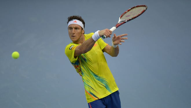Juan Monaco of Argentina lines up a backhand during his victory Kei Nishikori of Japan in the semifinals on the Malaysia Open.