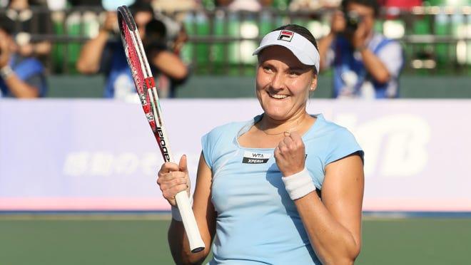 Nadia Petrova of Russia celebrates her win against Agnieszka Radwanska of Poland in the Pan Pacific Open.