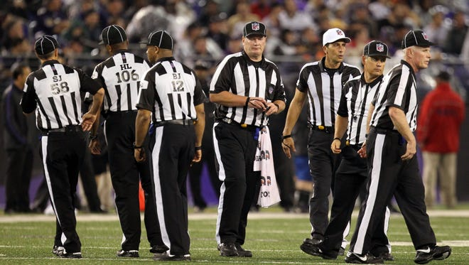 Regular referees were back on the field for Thursday night's game between the Ravens and Browns.