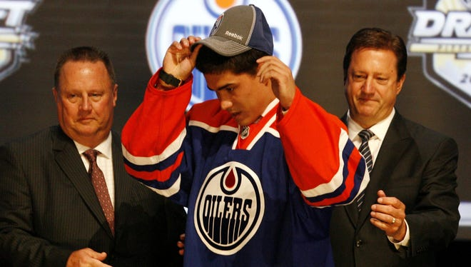 Nail Yakupov puts on a cap after being selected as the No. 1 overall draft pick in 2012 by the Edmonton Oilers.