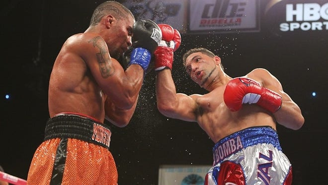 Edwin Rodriguez, right, drills Jason Escalera with a right uppercut during their fight Saturday night.