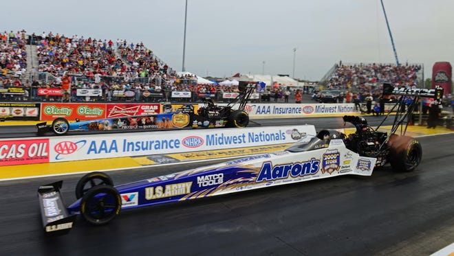 Antron Brown, near, raced to the Top Fuel win Sunday at the Midwest Nationals for his sixth victory of the season.