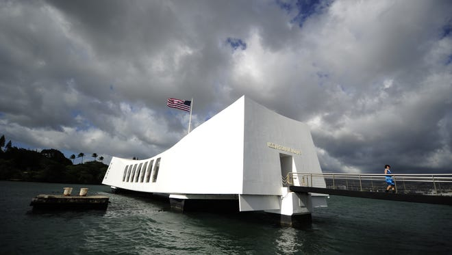 Visitors tour the USS Arizona memorial at the Pearl Harbor historical site and memorial in Honolulu, Hawaii. The U.S. Navy wants to cover a famous runway in Pearl Harbor with solar panels.