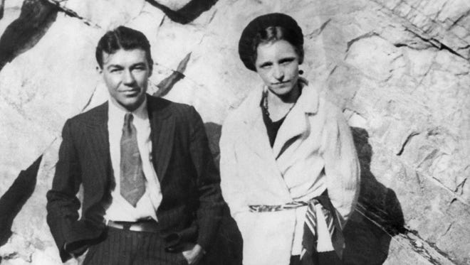Outlaws Bonnie Parker (R) and Clyde Barrow (L) in the 1930s. Two guns they once owned fetched $504K at an RR Auction in Amherst, New Hampshire.