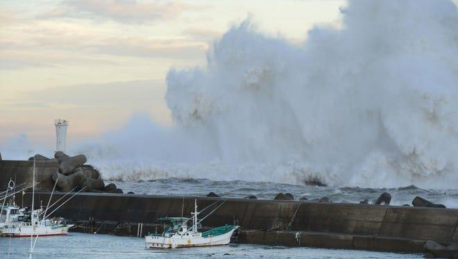 High waves hit a breakwater in Kihocho, Mie prefecture, western Japan on Sept. 30. The typhoon is headed towards Tokyo.