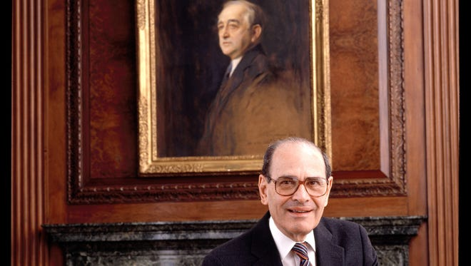 Arthur Ochs Sulzberger in the New York Times boardroom in 1992, beneath a picture of Arthur Ochs, in New York.