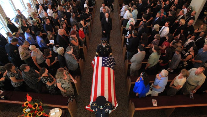In this file photo, an Army National Guard honor guard escorts the casket of U.S. Army Chief Warrant Officer 2 Suresh Krause from the chapel at Forest Lawn Memorial Park and Mortuary in Cathedral City, Calif. on Aug. 30. Krause, 29, was killed in action Aug. 16.