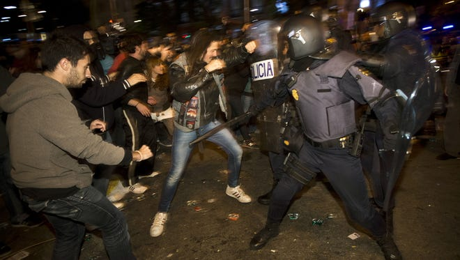 Police clash with anti-austerity protestors in front of Parliament in Madrid Sept. 29, 2012.