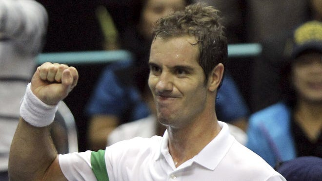 Richard Gasquet of France celebrates after defeating compatriot Gilles Simon in the Thailand Open final.