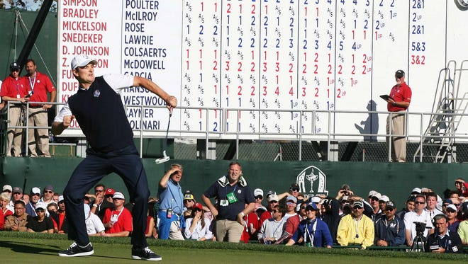 Justin Rose celebrates his victory against Phil Mickelson on the 18th green Sunday at the Ryder Cup.