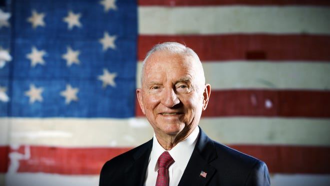 "Former Presidential candidate Ross Perot stands in front of a historic USS Constitution ""Old Ironsides"" American Flag in his offices in Plano, Texas."