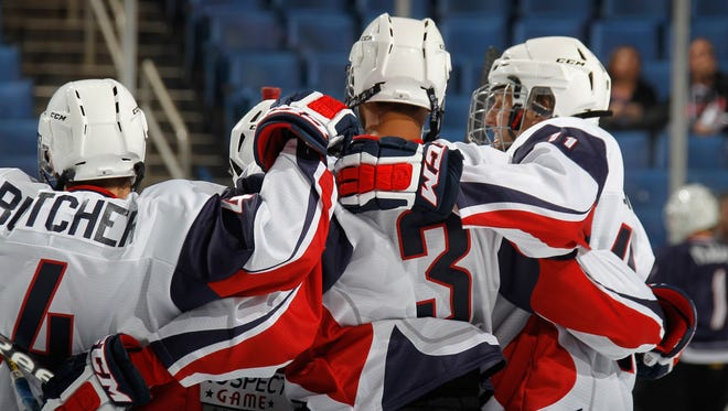 Seth Jones (3) is congratulated by teammates after scoring in the second period Saturday night.